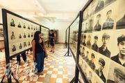 每個被關進Tuol Sleng集中營的囚犯都會照一張照片,被關進去的約兩萬人中只有7人生還,這張照片成為絕大多數人的遺照。(胡景禧攝)