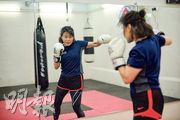 Anne由學拳到創辦泰拳社企,過程中體會拳術運動不但能鍛煉體魄,還能增強自毅力和意志,改變人生。(鍾林枝攝)