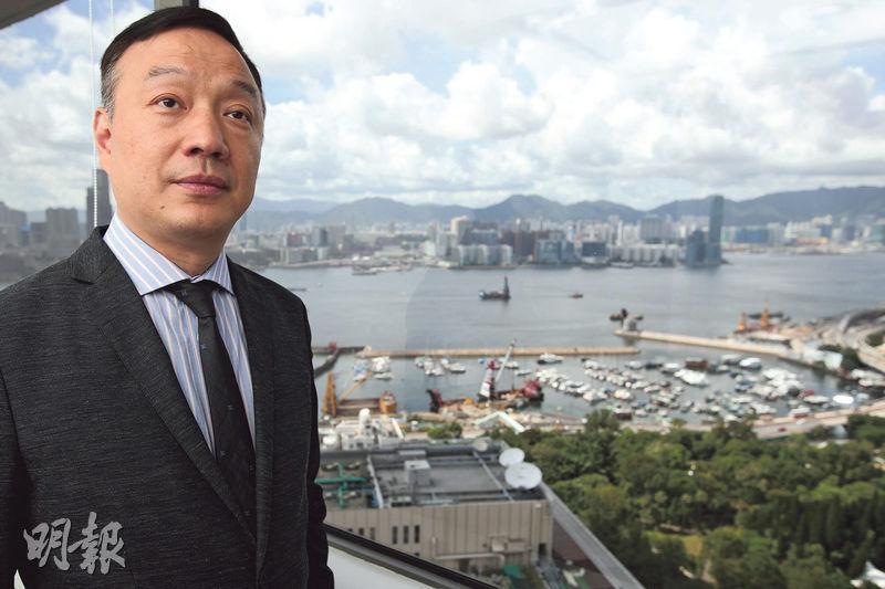 Q房網香港董事總經理陳坤興(圖)表示,公司希望加強網上和實體店的互補,目標是未來兩年,來自網上的生意可佔整體營業額的五成。(曾憲宗攝)
