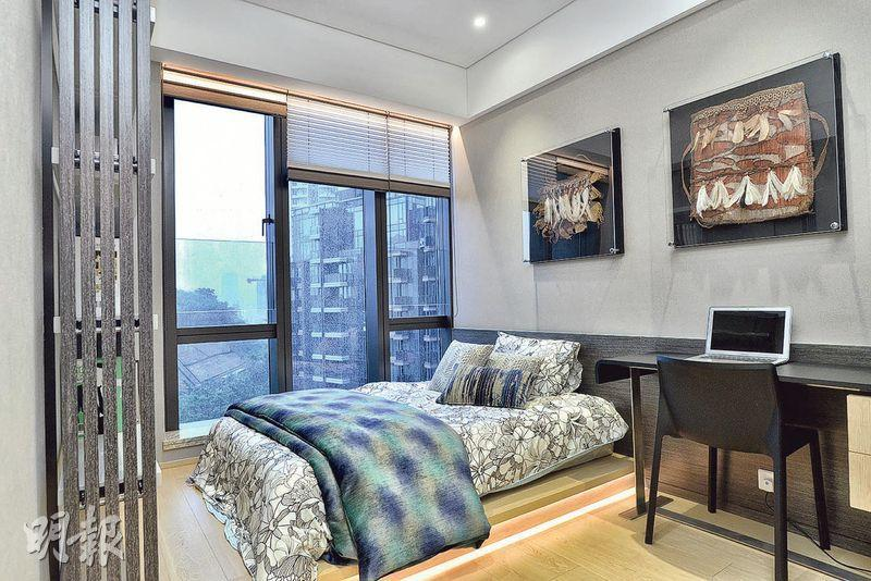 (7座23樓B室)﹕單位其中一個套房鋪設地台,擺放日式矮牀,簡約舒適。(馮凱鍵攝)
