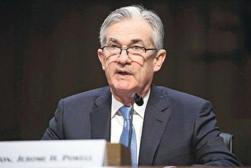 聯儲局主席提名人鮑威爾(圖),昨出席參院銀行委員會的提名確認聽證會時預期,美國利率將進一步上升,並將逐步縮表。(法新社)