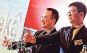雖然公司連續3年錄得虧損,但齊屹首席財務官王文飛(右)表示,公司今年首4個月已比去年同期錄得規模盈利。(劉焌陶攝)