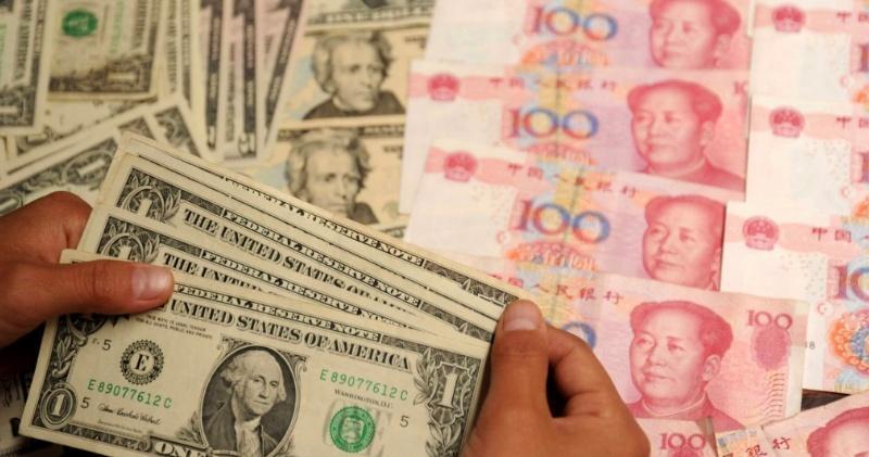 人幣中間價大升299點子 離岸價曾高見6.90