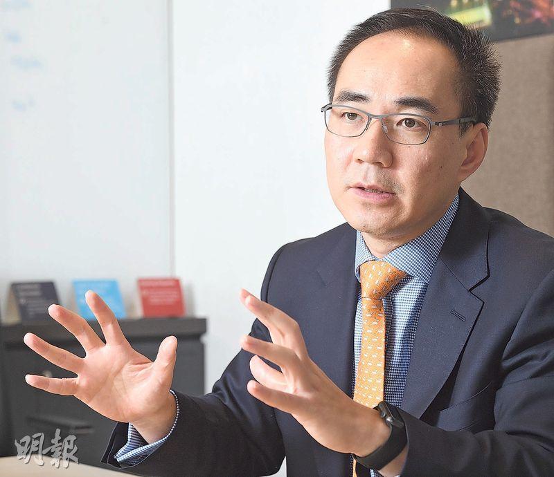 宏利陳致洲預測,港股明年下半年表現勝上半年。(劉焌陶攝)