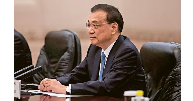 國務院總理李克強(圖)昨日上午開腔,罕有提及全面降準,傍晚人行隨即宣布降準1個百分點。(資料圖片)