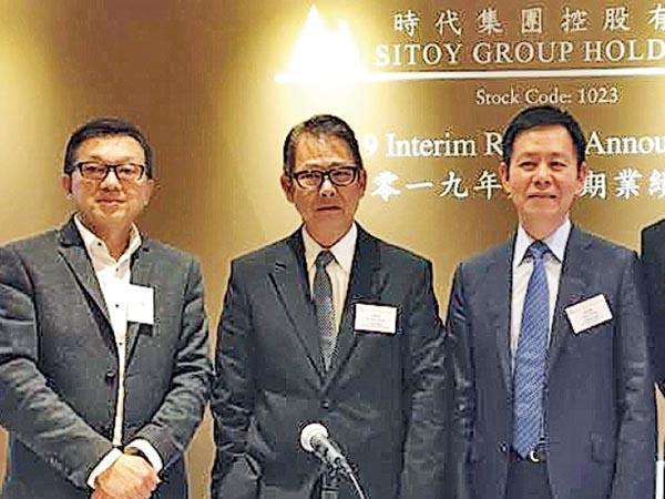 時代集團咋日公布業績。圖左起為集團首席財務官劉健成、主席楊華強、行政總裁楊和輝。