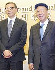 銀河娛樂副主席呂耀東(左)表示,集團正計劃投資15億元,為旗下澳門銀河及星際酒店進行翻新計劃。旁為集團主席呂志和。(中通社)