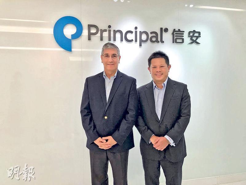 信安國際總裁兼行政總裁韋達志(左)表示,集團正計劃與建行成立一間合資公司。旁為信安金融集團亞洲區總裁張維義。