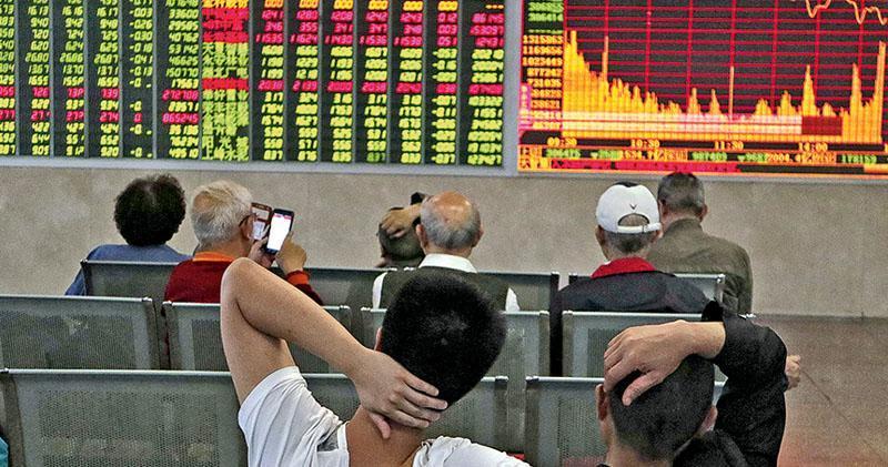內地股市全線低開 上證險守3000點