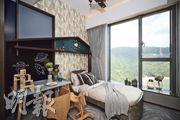 意堤8座16樓B室的示範單位其中一間睡房設計加入木馬及黑板等擺設。(曾憲宗攝)