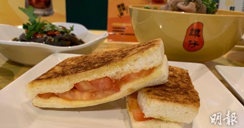 譚仔為慶祝中環新店開張而推出期間限定的特色早餐,包括「烘土匪芝士三文治系列」,將拿手的土匪雞翼及炸醬與三文治結合。