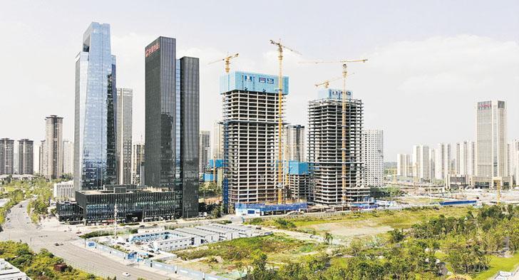 內地物業稅費開支比香港複雜得多,一手及二手樓、不同面積、樓價及物業性質,其稅費開支會有所不同。(中新社)