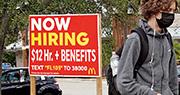 美國上周五公布9月非農業就業人口遠低於市場預期,但同時公布的平均時薪按月升0.6%勝預期,市場料聯儲局將如期於下月宣布減買債。圖為連鎖快餐店招聘廣告,開出時薪12美元。(法新社)