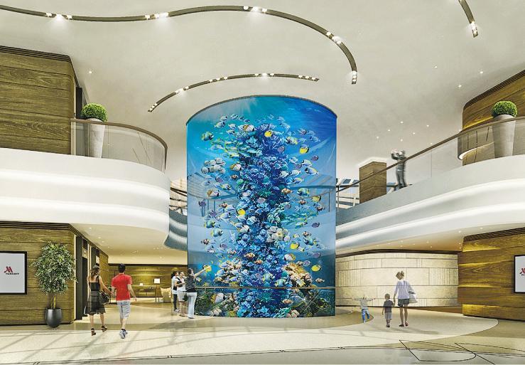暫預計喺6月13日開幕嘅香港海洋公園萬豪酒店有約471間客房,從模擬圖所見,大堂有個16米高嘅巨型圓柱形魚缸。(海洋公園提供)