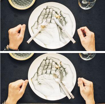 刀叉擺放——用餐中途需要離席或稍作停頓,刀叉在碟裏應擺成「八」字形,叉背朝上,刀刃朝內(上圖)。用餐結束後,傳統擺法是將刀叉併攏置在碟中四點方向,叉腹朝上,刀刃向內。另一擺法是將刀架在叉腹(下圖),避免侍應收拾時,刀叉發出碰撞聲音。(蘇智鑫攝)