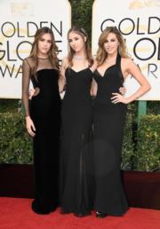 史泰龍的三位索千金擔任今年的金球小姐,三人很有默契地同時選擇了黑色晚裝。