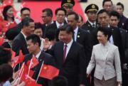 6月29日,國家主席習近平與夫人彭麗媛抵港。(法新社)