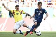 【世界盃‧日本對哥倫比亞】哥倫比亞James Rodriguez (左)(法新社)