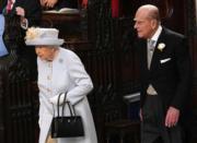 【尤金妮亞公主婚禮】2018年10月12日,英女王(左)與王夫菲臘親王(右)出席孫女尤金妮亞公主的婚禮。(法新社)