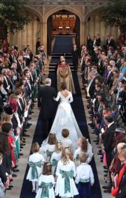 2018年10月12日,尤金妮亞公主(Princess Eugenie of York)與Jack Brooksbank,在溫莎堡的聖喬治教堂行禮。(法新社)
