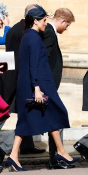 2018年10月12日,梅根(左)與哈里王子(右)出席英女王孫女、尤金妮亞公主的婚禮。(法新社)