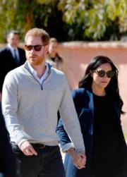 2019年2月24日,哈里王子(左)和梅根(右)外訪摩洛哥。(法新社)
