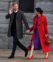2019年1月14日,哈里王子(左)和梅根(右)(法新社)