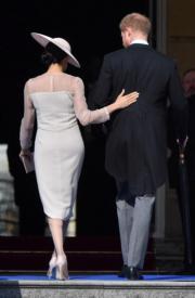 哈里王子(右)與梅根(左)(法新社)