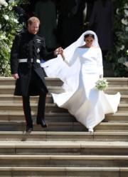 英國哈里王子(左)與梅根(右)5月19日舉行婚禮。(法新社)