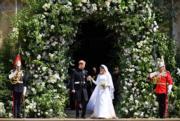 2018年5月19日,英國哈里王子(左)與梅根(右)結婚。(法新社)