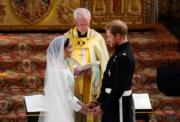 2018年5月19日,英國哈里王子(右)與梅根(左)結婚。(法新社)
