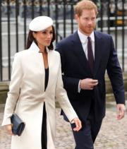 2018年3月12日是Commonwealth Day,馬克爾(左)與哈里王子(右)出席慶祝活動。(法新社)