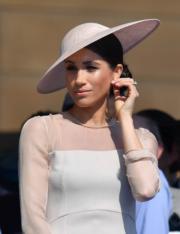 2018年5月22日,梅根穿了Slightly bespoke version of the Goat Fashion Flavia Dress 出席王儲查理斯70大壽慶祝活動。(法新社)