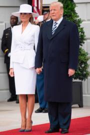 特朗普(右)與夫人梅拉尼婭(左)(法新社)