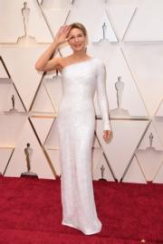 雲妮絲維嘉憑《星夢女神:茱地嘉蘭》封后,並以一身女神打扮出席頒獎禮。(法新社/明報製圖)