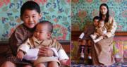 不丹國王家庭新照片 11月月曆桌布小王儲抱弟弟溫馨登場