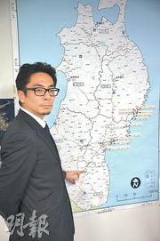 日本復興廳助理參事官鮎澤良史說,全部大米都要經過嚴格檢測。(林迎攝)