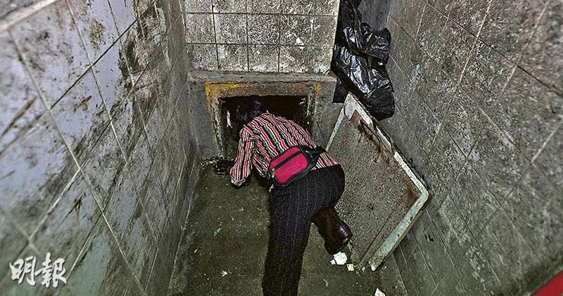 勞處指引落實參差 清潔工仍探頭垃圾槽 出事大廈槽口加鋼條 貼圖示教育